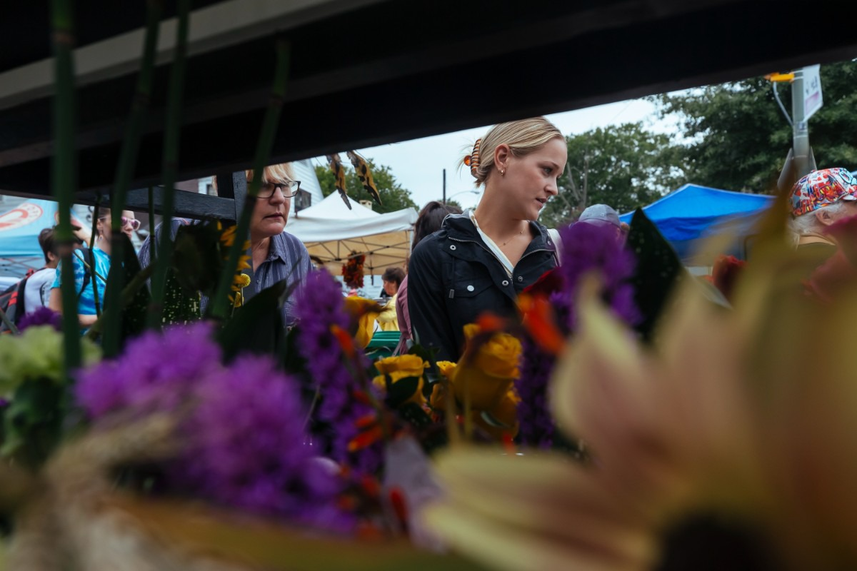 <strong>Callie (left) and Darrylee Arms check out blooms at Enchante Flower Shop.</strong> (Ziggy Mack/Special to The Daily Memphian)