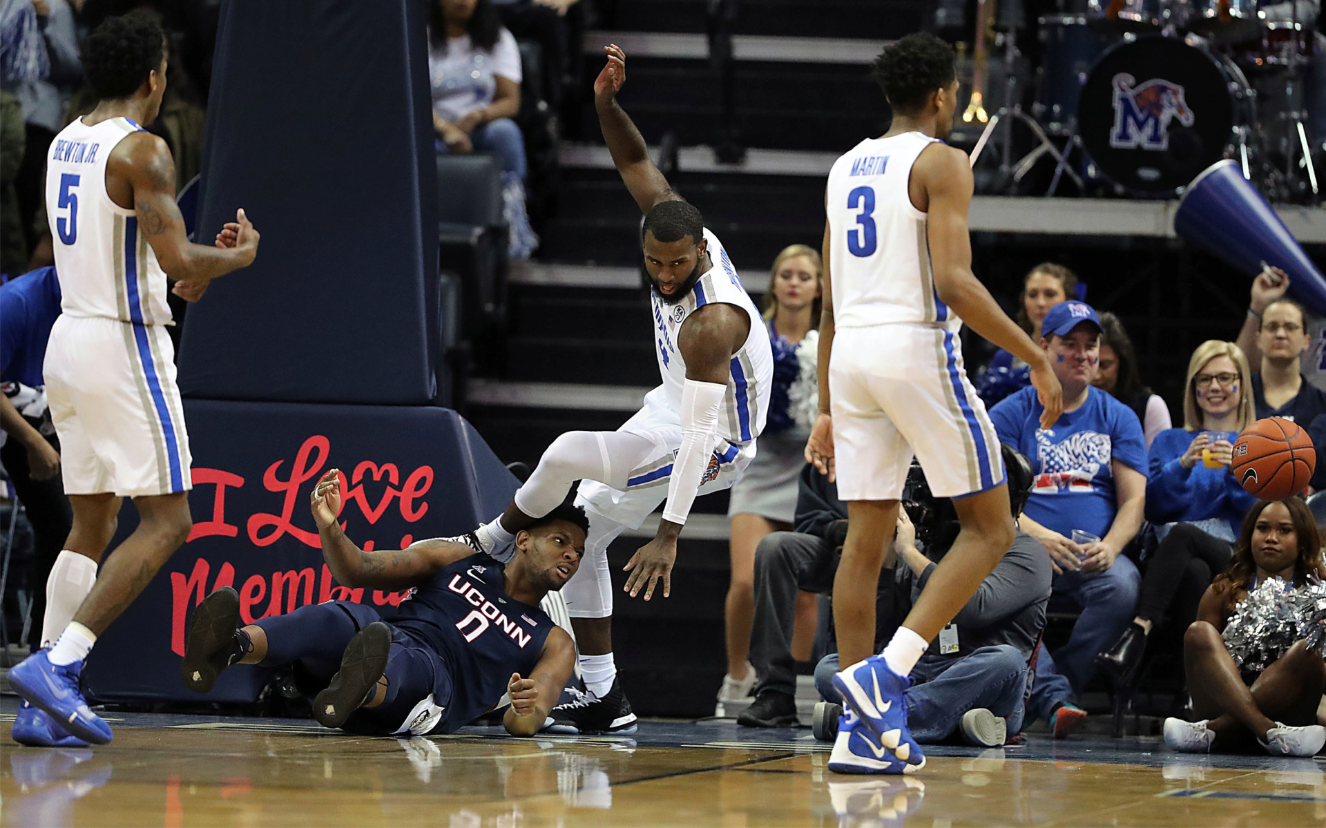 <strong>Memphis forward Raynere Thornton trips over UConn forward Eric Cobb while fighting over a loose ball during a 78-71 victory Sunday, Feb. 10.</strong> (Patrick Lantrip/Daily Memphian)