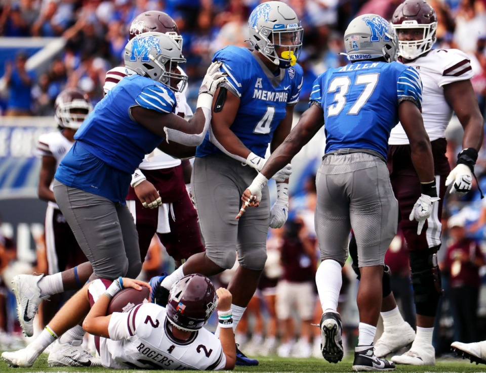 <strong>University of Memphis defensive lineman Maurice White (4) celebrates with teammates after sacking Mississippi State University quarterback Will Rogers III (2).</strong> (Patrick Lantrip/Daily Memphian)