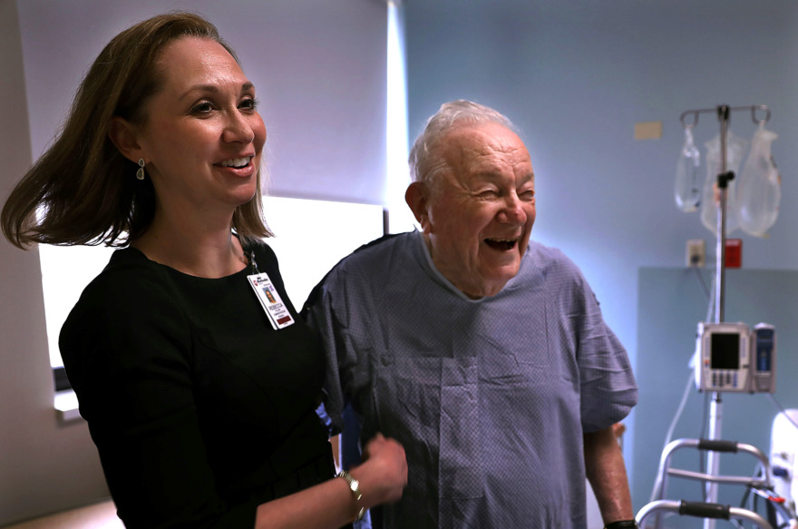 "<strong>Rebecca Cullison spends some time with one of her favorite patients, Martin Hinchin, a 100-year-old former rabbi who now lives in The Village at Germantown. Hinchin was at Methodist-Germantown for a procedure. ""Old age is not for sissies,"" he said.</strong> (Patrick Lantrip/Daily Memphian)"