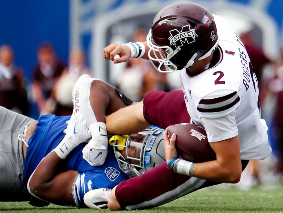 <strong>University of Memphis defensive lineman Maurice White (4) sacks Mississippi State University quarterback Will Rogers III (2) during a Sept. 18, 2021 game at the Liberty Bowl Memorial Stadium.</strong> (Patrick Lantrip/Daily Memphian)