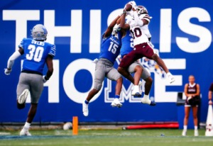 <strong>University of Memphis defensive back Quindell Johnson (15) aims to block a catch by Mississippi State wide receiver Makai Polk (10).</strong> (Patrick Lantrip/Daily Memphian)