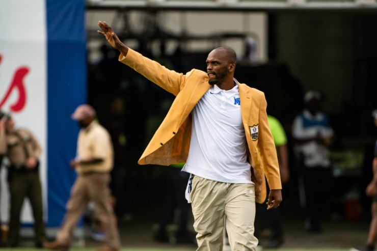 <strong>Wearing his gold Pro Football Hall of Fame blazer, Isaac Bruce greets the crowd during the University of Memphis vs Mississippi State game Saturday, Sept. 18, 2021 at Liberty Bowl Memorial Stadium.</strong> (Matthew A. Smith/Memphis Athletics)