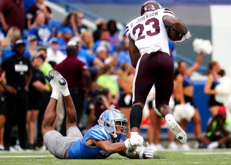 <strong>University of Memphis cornerback Greg Rubin (24) barely gets a hand on Mississippi State University running back Dillon Johnson (23).</strong> (Patrick Lantrip/Daily Memphian)