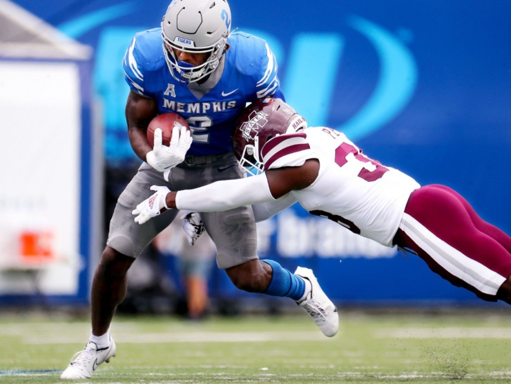 <strong>University of Memphis running back Rodrigues Clark (2) breaks a tackle from Mississippi State University safety Jay Jimison (36) during a Sept. 18, 2021 game at the Liberty Bowl Memorial Stadium.</strong> (Patrick Lantrip/Daily Memphian)