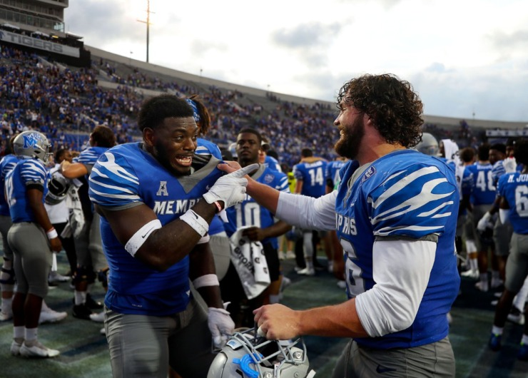 <strong>Tigers players celebrate after the Sept. 18, 2021 victory at the Liberty Bowl Memorial Stadium.</strong> (Patrick Lantrip/Daily Memphian)