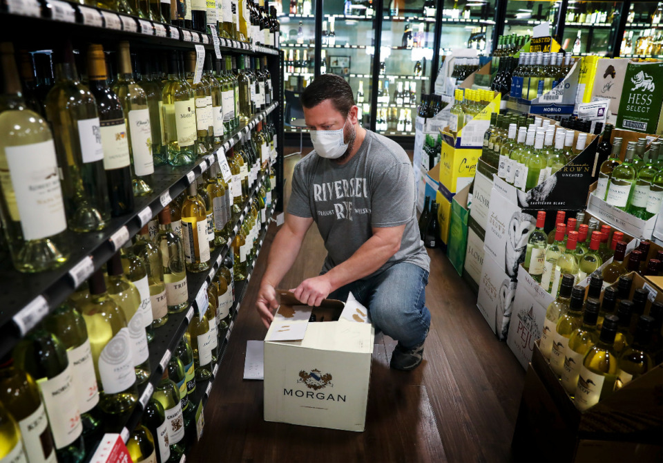 <strong>Buster&rsquo;s employee Chris Miller fills online alcohol orders on April 16, 2020. Local consumers are more optimistic about the economy for the next year, but hesitant about big-ticket purchases, according to the 2021 Memphis Consumer Sentiment Survey.&nbsp;</strong>(Mark Weber/Daily Memphian)