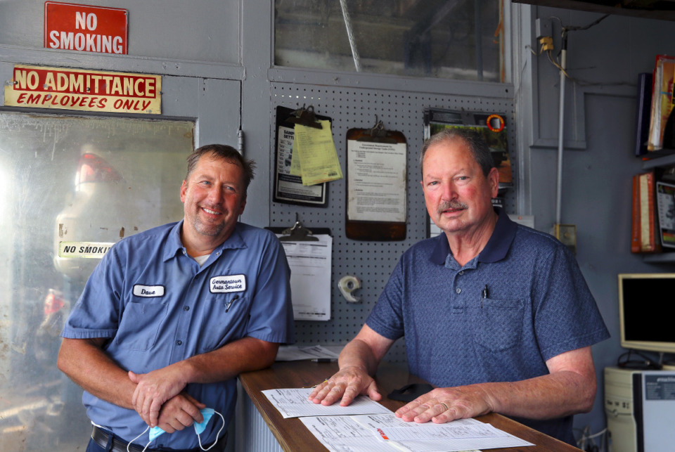 <strong>Dave Jones (left) and his father David Jones pose for a portrait inside their Germantown mechanic shop/gas station Sept. 21, 2021.</strong> (Patrick Lantrip/Daily Memphian)