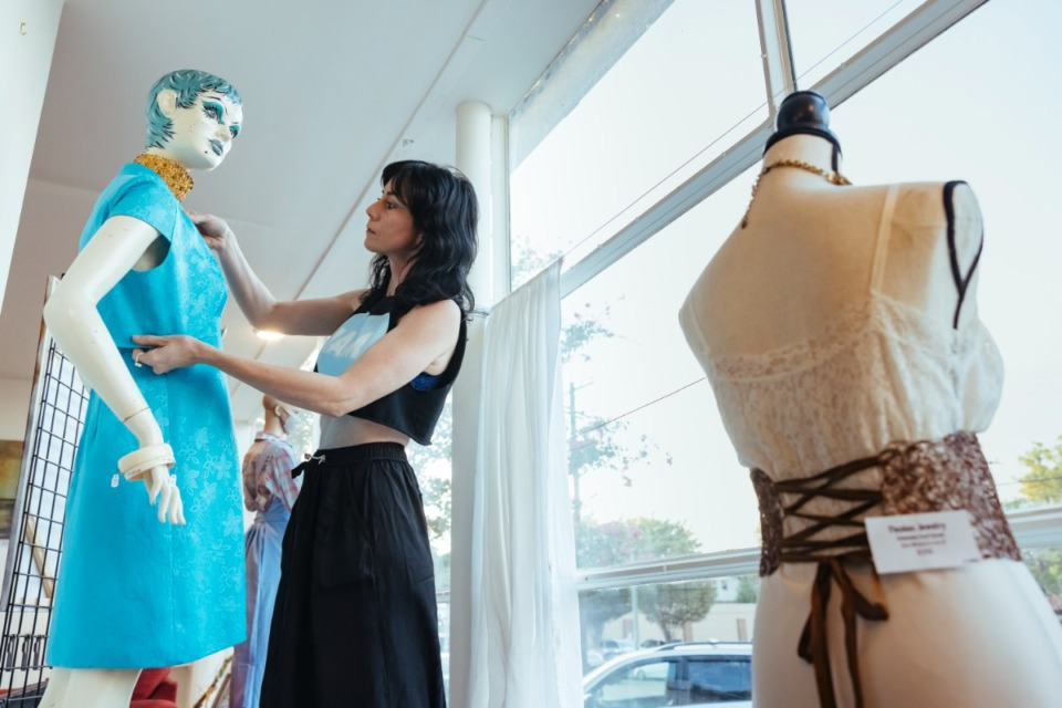<strong>Artist Jeni Harris arranges vintage fashion pieces on mannequins inside IAM Indie Artists Market in Midtown on September 16, 2021</strong> (Ziggy Mack/Special to The Daily Memphian)
