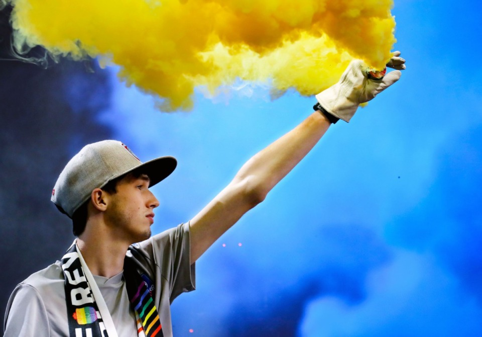 <strong>A member of the Bluff City Mafia lights up a smoke grenade on Sept. 22 before&nbsp; the home match against Indy Eleven.</strong> (Patrick Lantrip/Daily Memphian)