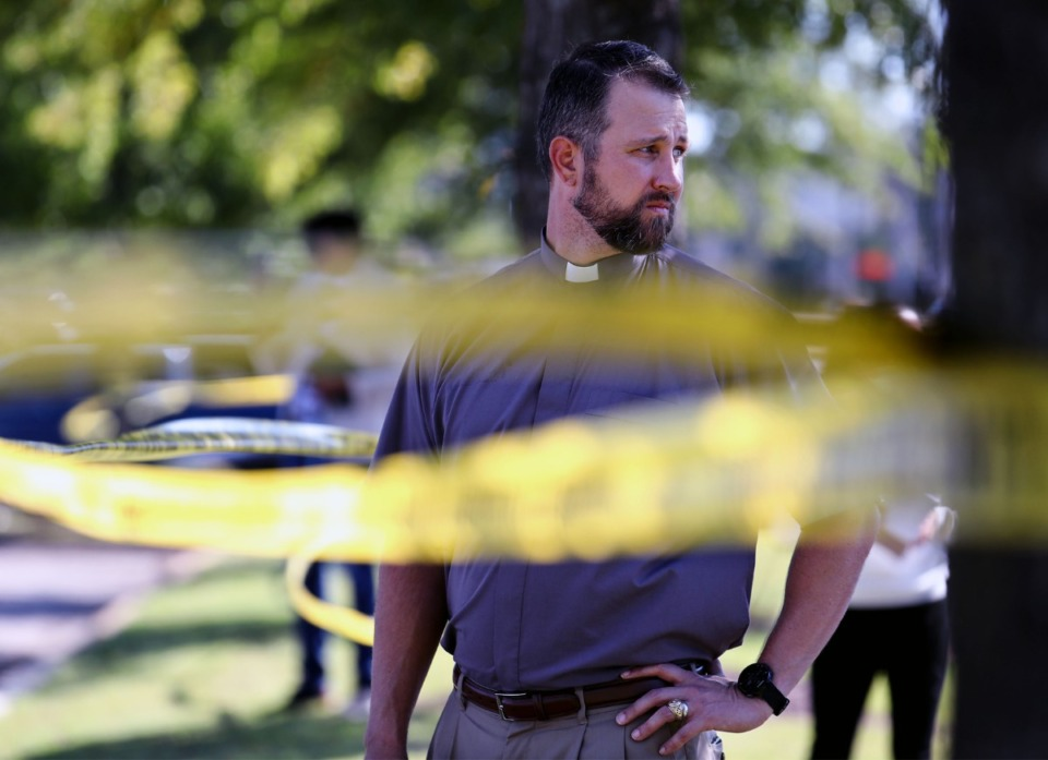<strong>Pastor Clayton Sellers of Faith Lutheran Church waits near the crime scene.</strong> (Patrick Lantrip/Daily Memphian)