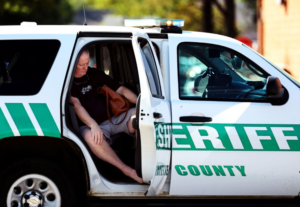 <strong>A survivor of the shooting sits in a Fayette County Sheriff&rsquo;s SUV in the Kroger parking lot.</strong> (Patrick Lantrip/Daily Memphian)