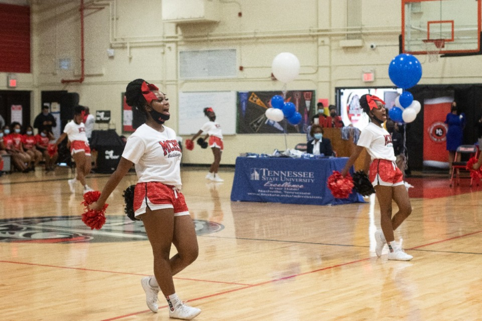 <strong>Middle College High School cheerleaders chant about Reimagining 901 at a school pep rally where the school's senior class was given scholarships to TSU.</strong> (Daja E. Henry/Daily Memphian)