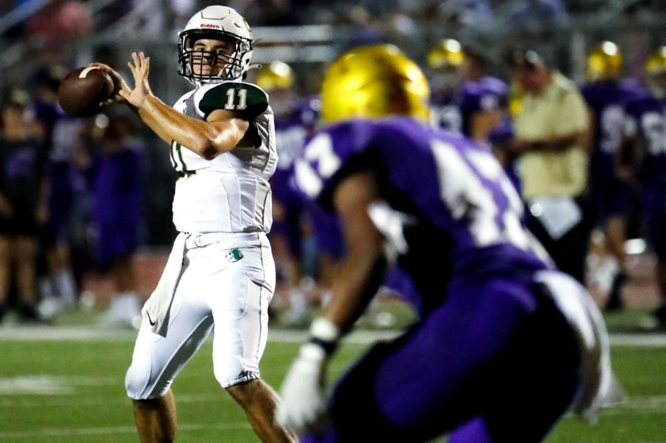 <strong>Briarcrest quarterback JD Sherrod (11) looks for an open receiver against Christian Brothers on Friday, Sept. 17. Briarcrest won 43-42 in double overtime.</strong> (Patrick Lantrip/Daily Memphian)