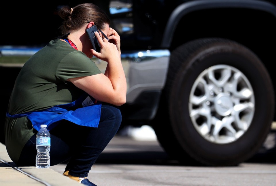 <strong>A survivor of the mass shooting at a Kroger in Collierville makes a call at the crime scene on Sept. 23, 2021.</strong> (Patrick Lantrip/Daily Memphian)