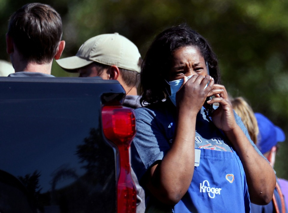 <strong>Survivors of a mass shooting at the Kroger store on Byhalia Road in Collierville gather in the parking lot Sept. 23, 2021.</strong> (Patrick Lantrip/Daily Memphian)
