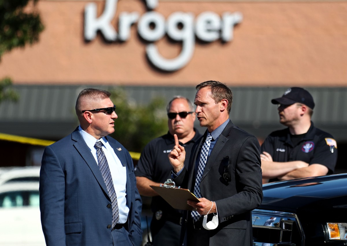 Law enforcement officers work the crime scene of a mass shooting at a Kroger in Collierville, Tennessee Sept. 23, 2021. (Patrick Lantrip/Daily Memphian)