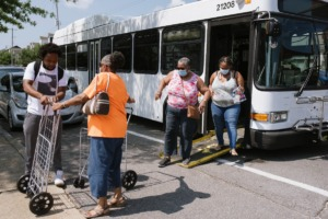 <strong>Residents exit a MATA bus that transported them from the Klondike and Smokey City neighborhood to the Downtown Farmers Market on July 24.</strong> (Lucy Garrett/Special to the Daily Memphian file)