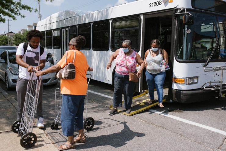 Residents exit a MATA bus that transported them from the Klondike and Smokey City neighborhood to the Downtown Farmers Market on July 24. (Lucy Garrett/Special to the Daily Memphian file)
