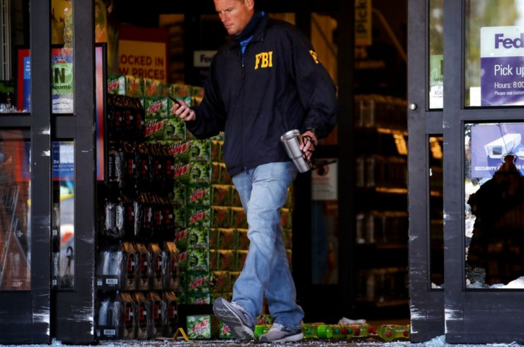 An FBI agent works the scene Friday, Sept. 24 at the Kroger on Byhalia Road in Collierville. (Patrick Lantrip/Daily Memphian)
