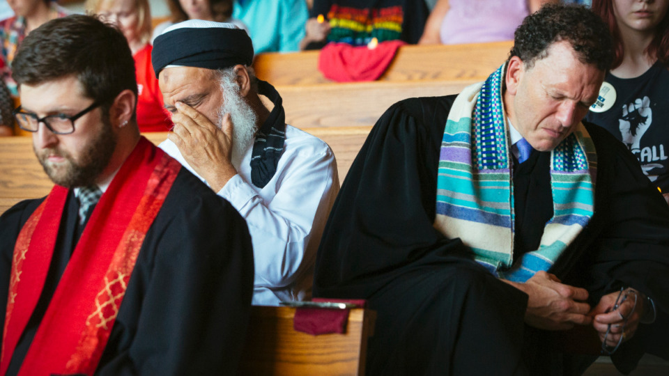 <strong>Reverend Sam Teitel (from left), Dr. Nabil Bayakly, and Rabbi Micah Greenstein react to the words and experiences of speaker Greg Diaz of Las Americas before prayer at Church on the River on Aug. 7, 2019.</strong> (Daily Memphian file)<strong><br /></strong>