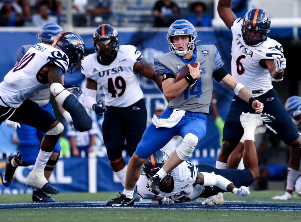 <strong>University of Memphis quarterback Seth Henigan (14) scrambles for a first down during a Sept. 25, 2021 game against University of Texas San Antonio at&nbsp; Liberty Bowl Memorial Stadium.</strong> (Patrick Lantrip/Daily Memphian)