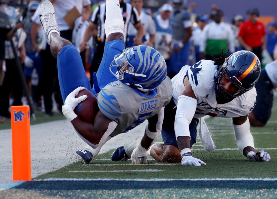<strong>University of Memphis tight end Sean Dykes (5) dives for the pylon in front of a University of Texas San Antonio defender.</strong> (Patrick Lantrip/Daily Memphian)