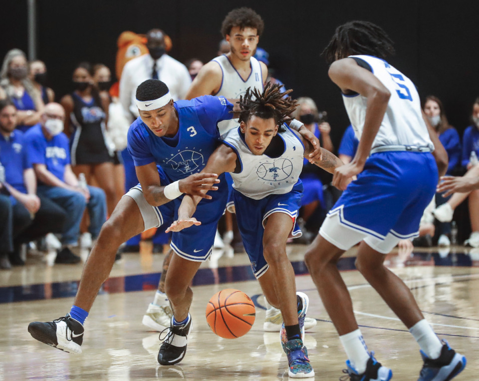 <strong>Memphis Tigers guard Landers Nolley II (left) battles forward Emoni Bates for a loose ball during the first day of practice on Tuesday, Sept. 28, 2021.</strong> (Mark Weber/The Daily Memphian)