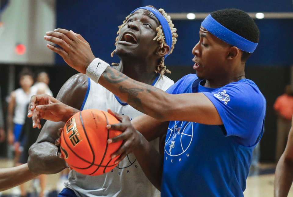 <strong>Tigers center Sam Onu (left) battles teammate Landers Nolley II (right) during the first day of practice on Tuesday, Sept. 28, 2021.</strong> (Mark Weber/The Daily Memphian)