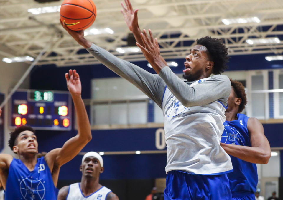 <strong>Tigers forward DeAndre Williams (right) drives the lane during the first day of practice on Tuesday, Sept. 28, 2021.</strong> (Mark Weber/The Daily Memphian)