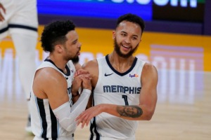 <strong>Memphis Grizzlies guard Dillon Brooks, left, and forward Kyle Anderson congratulate each other during a timeout in the first half of the team's NBA basketball game against the Los Angeles Lakers on Friday, Feb. 12, 2021, in Los Angeles.</strong> (AP Photo/Mark J. Terrill)