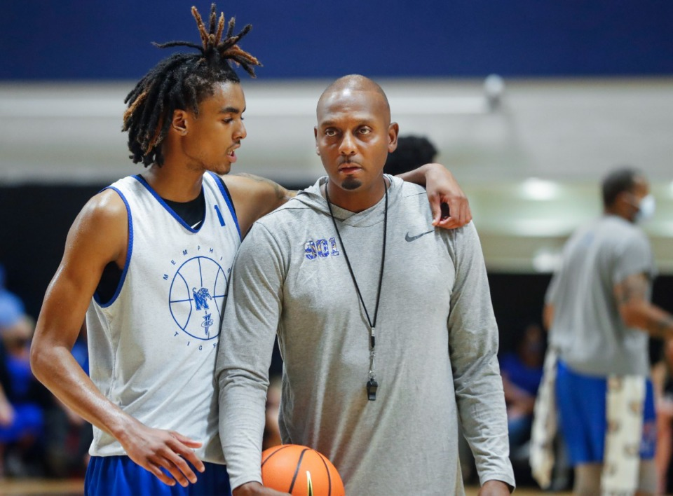<strong>Tigers forward Emoni Bates (left) chats with head coach Penny Hardaway (right) during the Tigers&rsquo; first practice Tuesday, Sept. 28, 2021.</strong> (Mark Weber/The Daily Memphian)