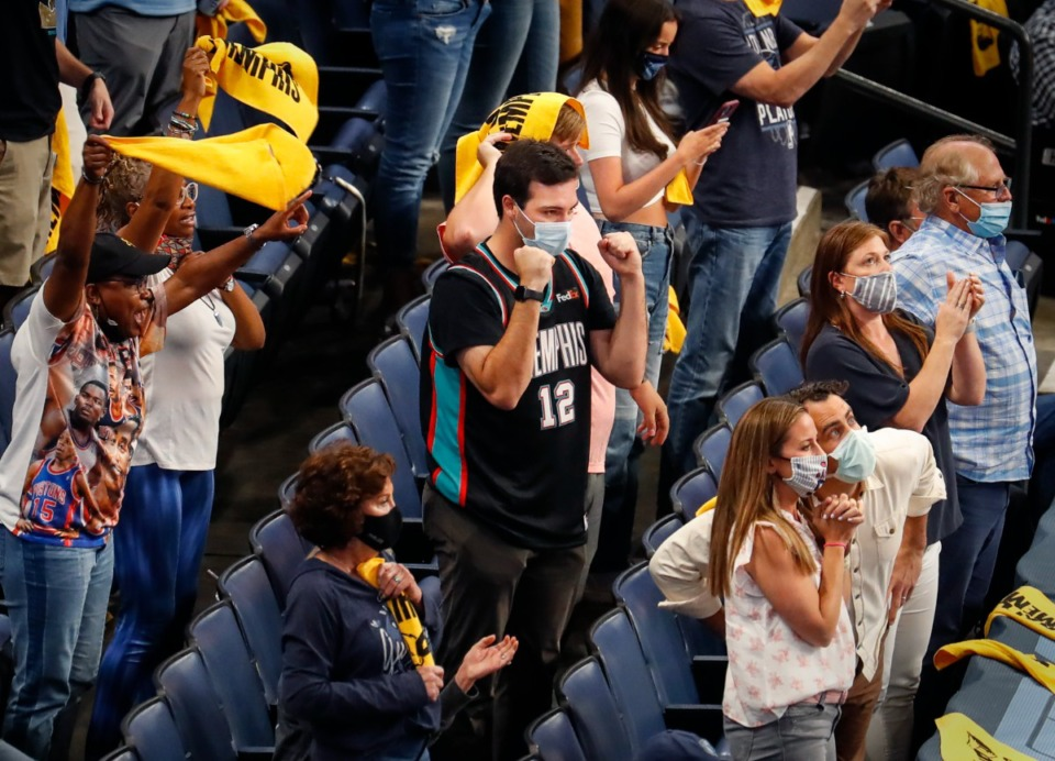 <strong>Memphis Grizzlies fans celebrate a 100-96 victory over the San Antonio Spurs on Wednesday, May 19, 2021. Grizzlies and Tigers fans shared a variety of reactions on social media to the FedexForum vaccination policy.</strong> (Mark Weber/The Daily Memphian)
