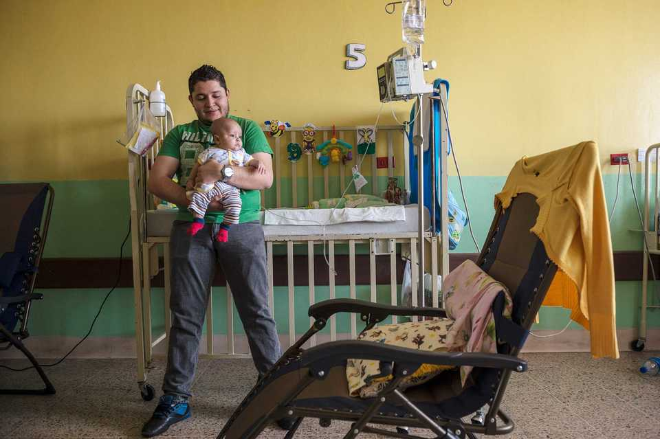 <strong>A young patient and his father at Centro Medico Ayudame a Vivir for Pediatric Cancer Treatment in San Salvador, El Salvador. </strong>(Photo courtesy of Scott A. Woodward)