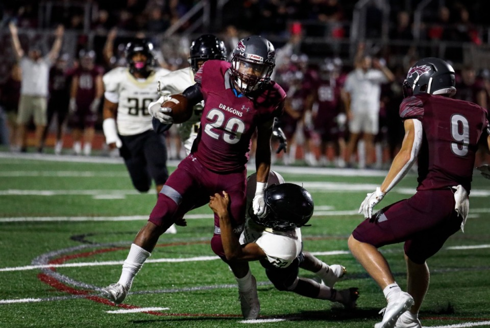 <strong>Collierville running back Troy Martin (middle) scrambles for a touchdown on Sept. 24, 2021. The win over Whitehaven takes the Dragons into the game against Germantown (5-1) Friday with a perfect 6-0 record.</strong> (Mark Weber/The Daily Memphian)