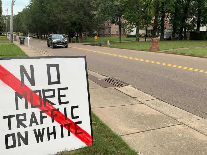 <strong>Residents along White Road have signs in their yards opposing a mixed-use development that proposes a cut through to White. The proposal was scheduled for review Thursday by the Planning Commission but has been deferred to a later date.</strong> (Abigail Warren/Daily Memphian)
