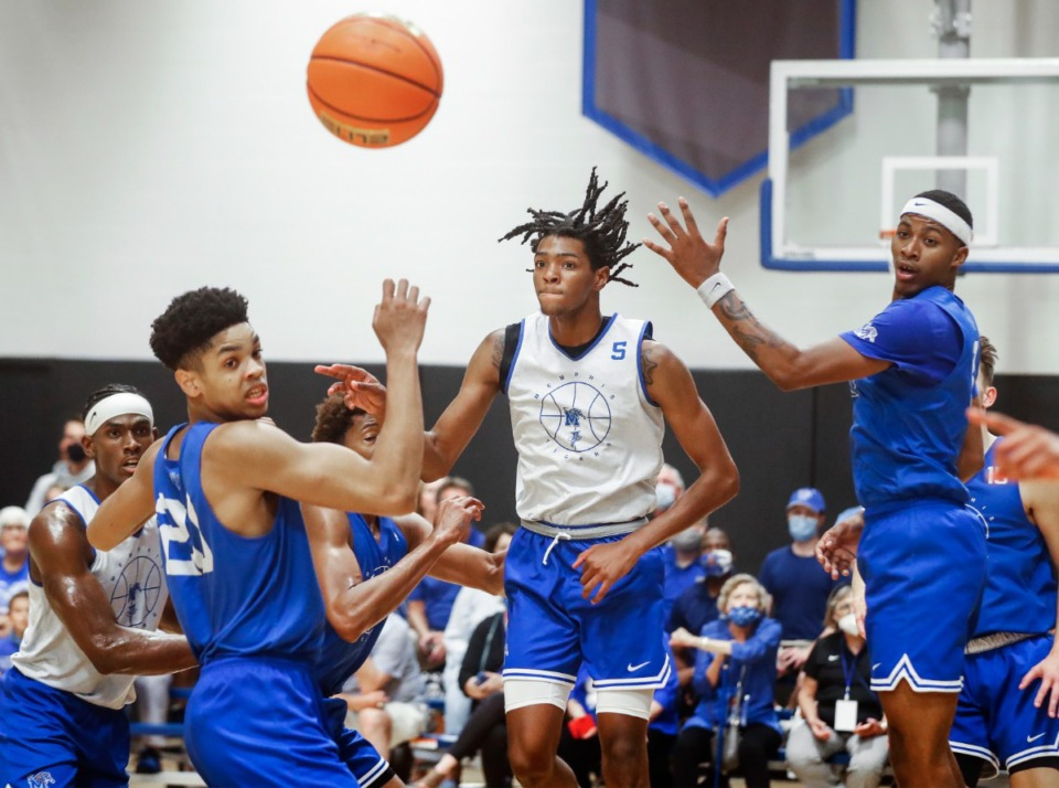 <strong>Tigers forward Johnathan Lawson (middle) makes a pass during the first day of practice on Tuesday, Sept. 28, 2021. Meanwhile, the football team is starting conference play.</strong> (Mark Weber/The Daily Memphian)
