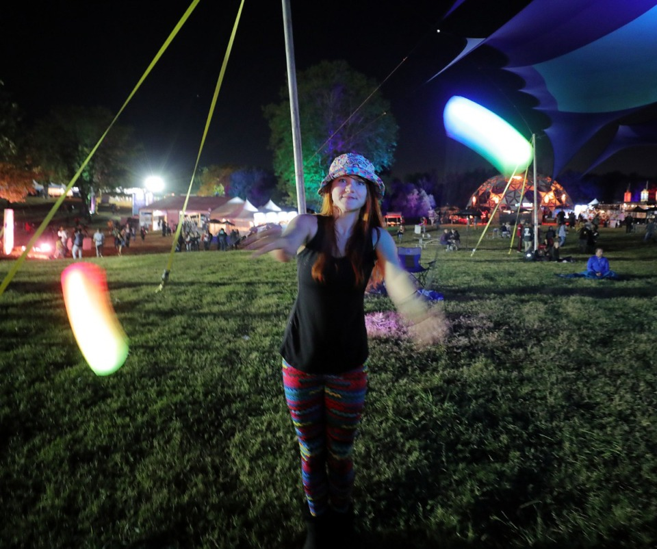 <strong>Mary Katherine Cranford dances with neon lights during the Raconteurs at the 2019 Mempho Music Festival at Shelby Farms.</strong> (Patrick Lantrip/Daily Memphian file)