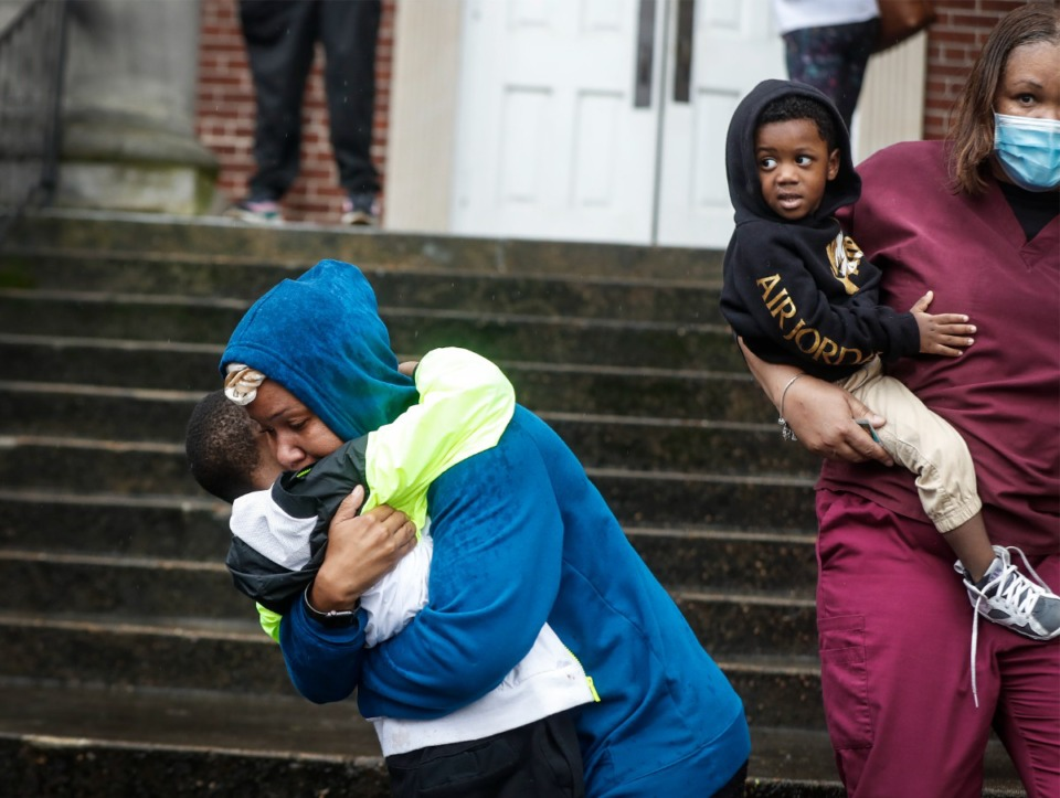 <strong>Relieved familied pick up students at Metropolitan Baptist Church Thursday following the shooting at Cummings Elementary School.</strong> (Mark Weber/The Daily Memphian)