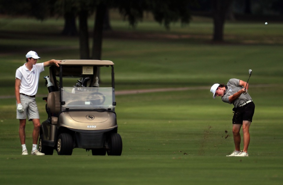 <strong>Davis Byrd hits from the fairway while Clarence Chapman looks on at the Ronnie Wenzler golf tournament at Windyke County Club on Aug. 26. Byrd and Jackson McCommon will lead Houston High in the tournament.</strong> (Patrick Lantrip/Daily Memphian)