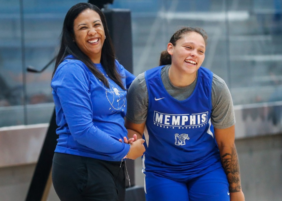 <strong>University of Memphis Lady Tigers head coach Katrina Merriweather (left) jokes with Makaiya Brooks (right) during practice on Friday, Oct. 1, 2021.</strong> (Mark Weber/The Daily Memphian)