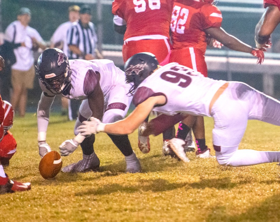 <strong>Collierville High School's Donovan Mathena and Sam Hultz grabs a loose ball after Germantown fumbles on the 20-yard line in Germantown, Friday, Oct. 1, 2021.</strong> (Greg Campbell/Special to The Daily Memphian)