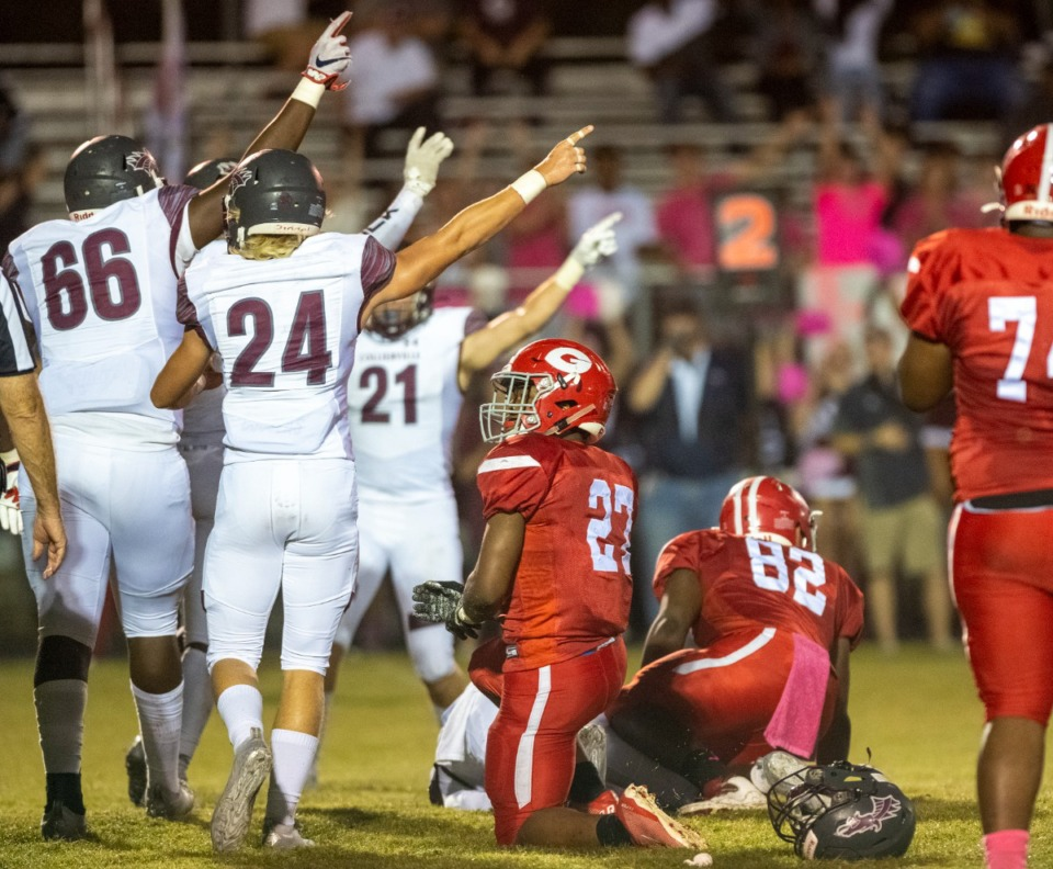 <strong>Collierville's defensive line signals a captured fumble in Friday's game against Germantown, Friday, Oct. 1, 2021.</strong> (Greg Campbell/Special to The Daily Memphian)