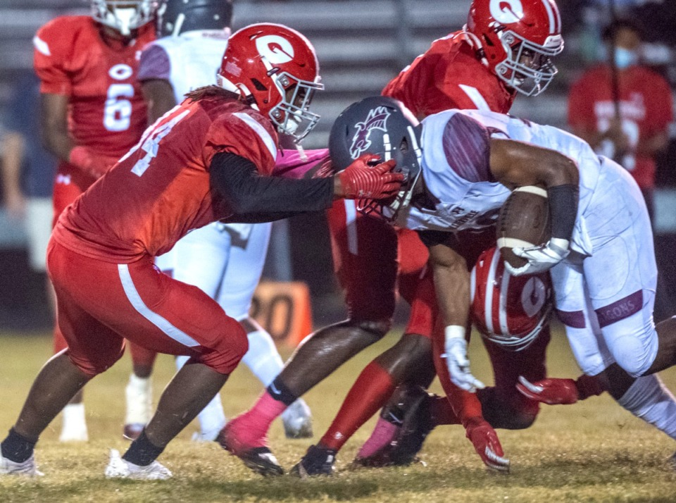 <strong>Germantown's Micah Satcher heads off Collierville High School's Troy Martin in Friday's physical contest between the the Dragons and the Red Devils in Germantown.</strong>&nbsp;(Greg Campbell/Special to The Daily Memphian)