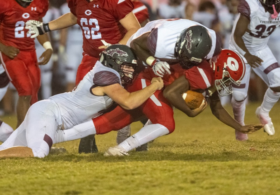 <strong>Germantown&rsquo;s quarterback is brought down by Collierville&rsquo;s Brayden Hendricks and Jaden McKenney in Friday's game in Germantown.</strong> (Greg Campbell/Special to The Daily Memphian)