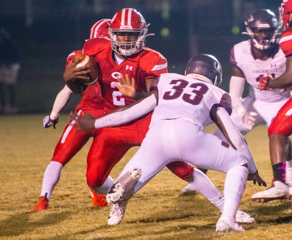 <strong>Germantown quarterback Tykwon Wade tries to run past Collierville's Gyasi Wallace in Friday's match in Germantown on Friday, Oct. 1, 2021.</strong> (Greg Campbell/Special to The Daily Memphian)
