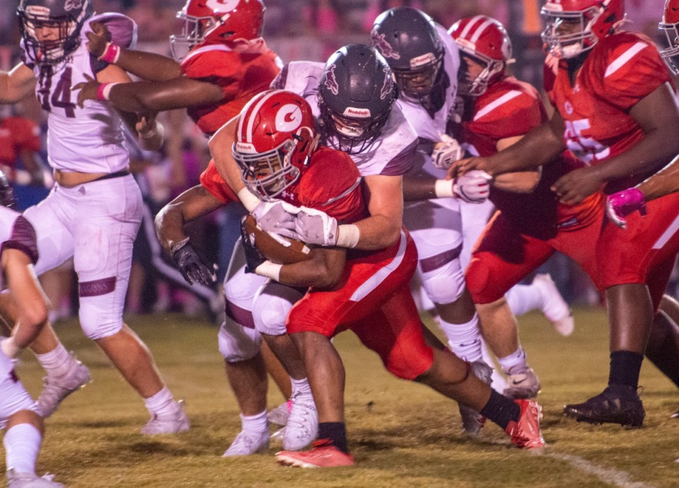 <strong>Germantown High School running back McCobian Williams is brought down by Collierville's Brayden Hendricks.</strong> (Greg Campbell/Special to The Daily Memphian)