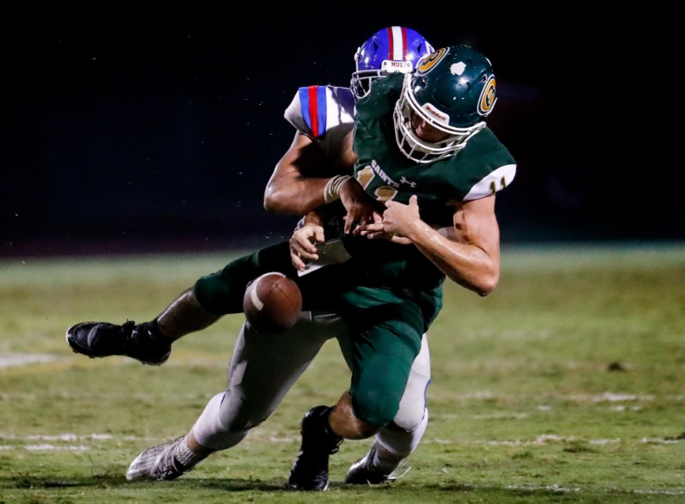 <strong>Briarcrest quarterback JD Sherrod (front) fumbles the ball after being tackled by MUS defender Stryker Aitken (back) on Friday, Oct. 1, 2021. (</strong>Mark Weber/The Daily Memphian)