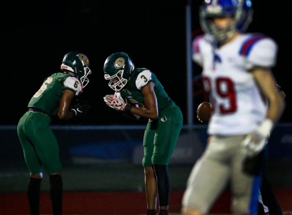 <strong>Briarcrest receiver Max Carroll (middle) celebrates a touchdown against MUS on Friday, Oct. 1, 2021.</strong> (Mark Weber/The Daily Memphian)