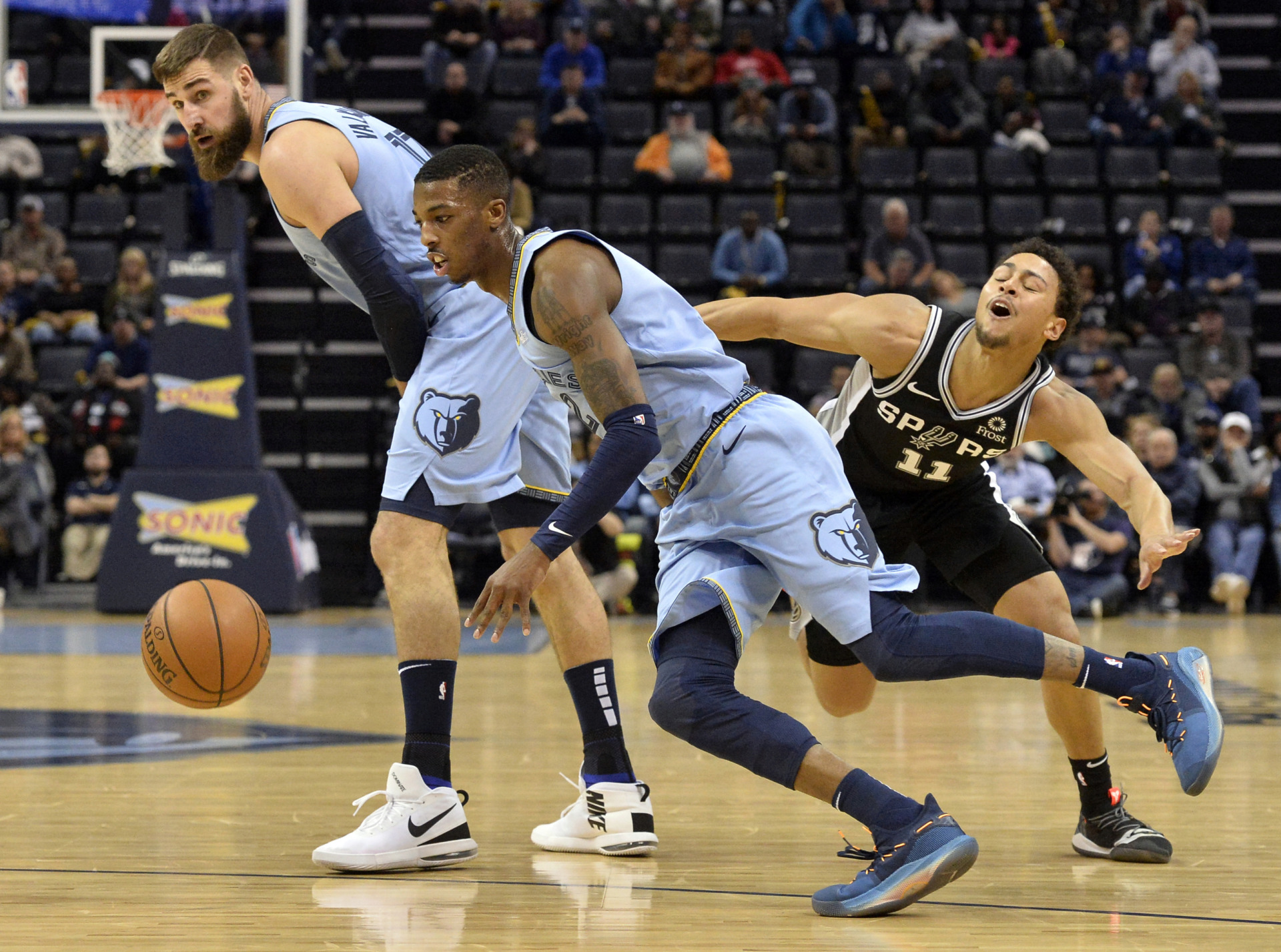 <span><strong>Memphis Grizzlies guard Delon Wright (2) drives around San Antonio Spurs guard Bryn Forbes (11) with help from Grizzlies center Jonas Valanciunas during the first half of an NBA basketball game Tuesday, Feb. 12, 2019, in Memphis, Tenn.</strong> (AP Photo/Brandon Dill)</span>